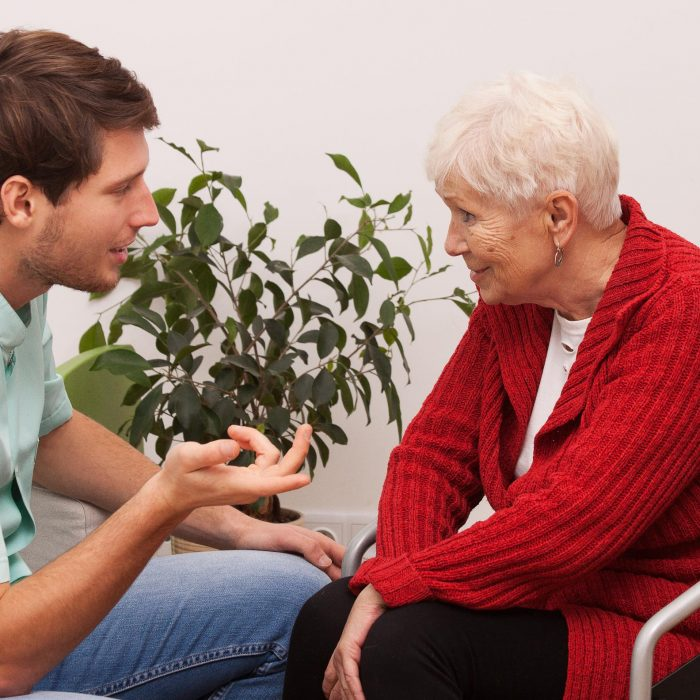 Nurse keeping company to disabled elderly lonley person