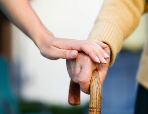 21829681 - doctor holding a senior patiens 's hand on a walking stick - special medical care concept for alzheimer 's syndrome.